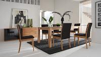 Imagen de decoracion de living comedor sencillo y moderno con mesa y silla de madera con  contrastes entre los colores negros de los respaldos de las sillas y la alfombra contra los blancos del piso y las paredes