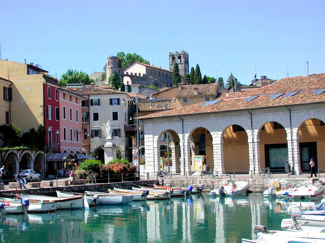 The old port of Desenzano on Lake Garda in Italy with its medieval castle guarding over the village below.