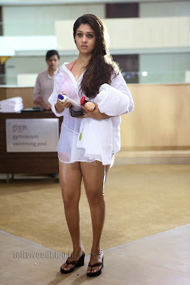 Sizzling Nayanthara latest hot transparent white thigh dress photos