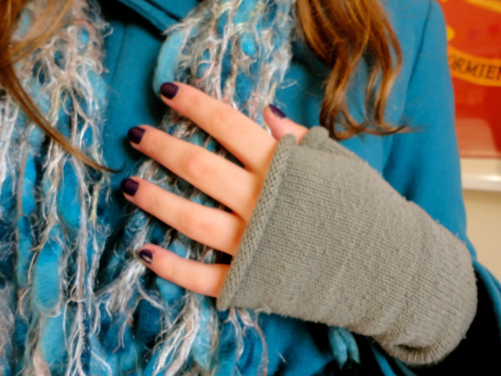 grey fingerless gloves and blue winter scarf