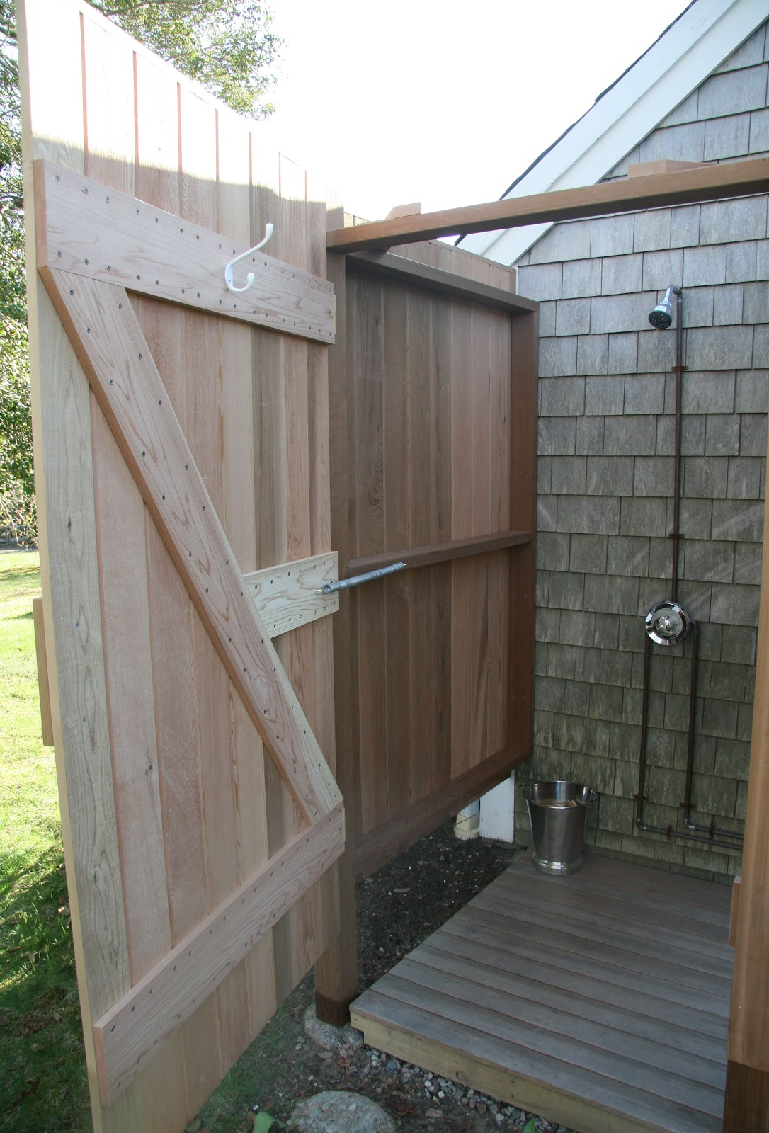 an old farm  building an outdoor shower