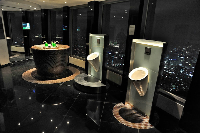 Beatifully designed urinals in the men's restroom overlook the city of  title=