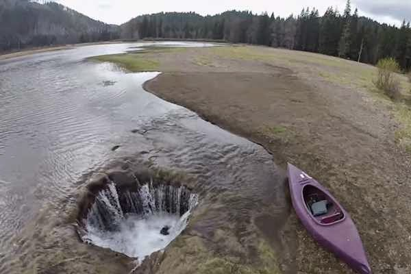All The Water In This Lake Vanishes Down a Hole Every Summer