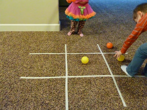 http://www.whattoexpect.com/blogs/astudentatmamauniversity/indoor-family-activities-just-add-masking-tape