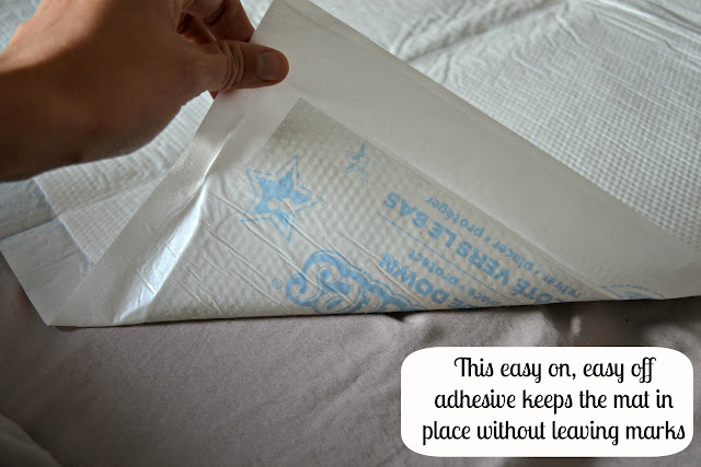 GoodNites disposable bed mats with adhesive stick to sheets with no residue  #HuggiesWalmart