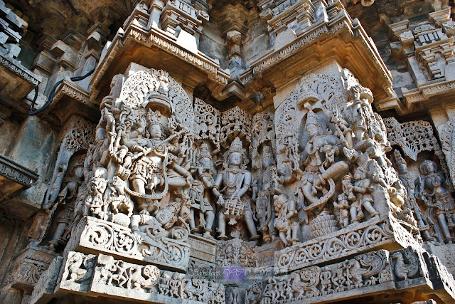 Wall sculptures with drum dancer at the center, here the ropes of the dhol or dholi is carved out of the stone leaving behind hollow sections inside, giving a view of a real Dhol or Hand Drum