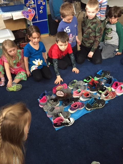 How many kindergarten shoes does it take to fill a T-Rex footprint?