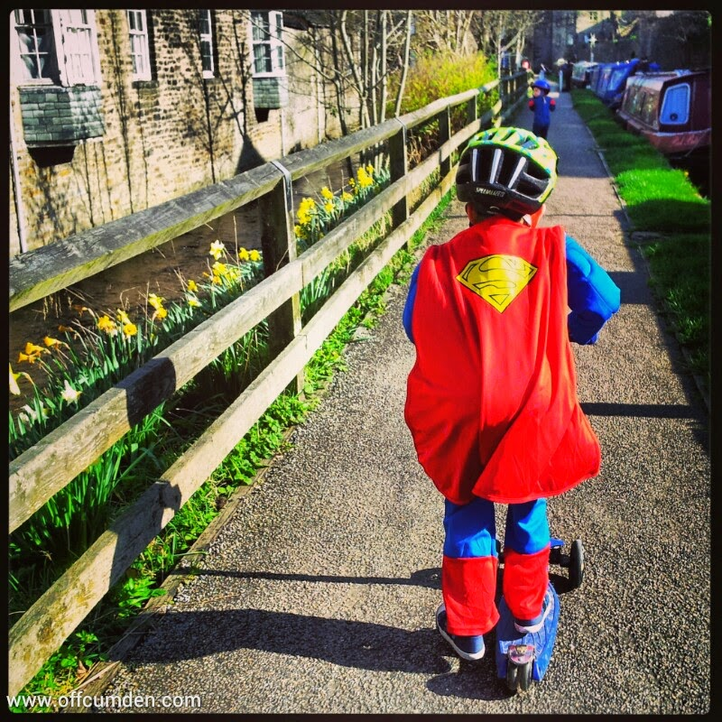 superman on a scooter