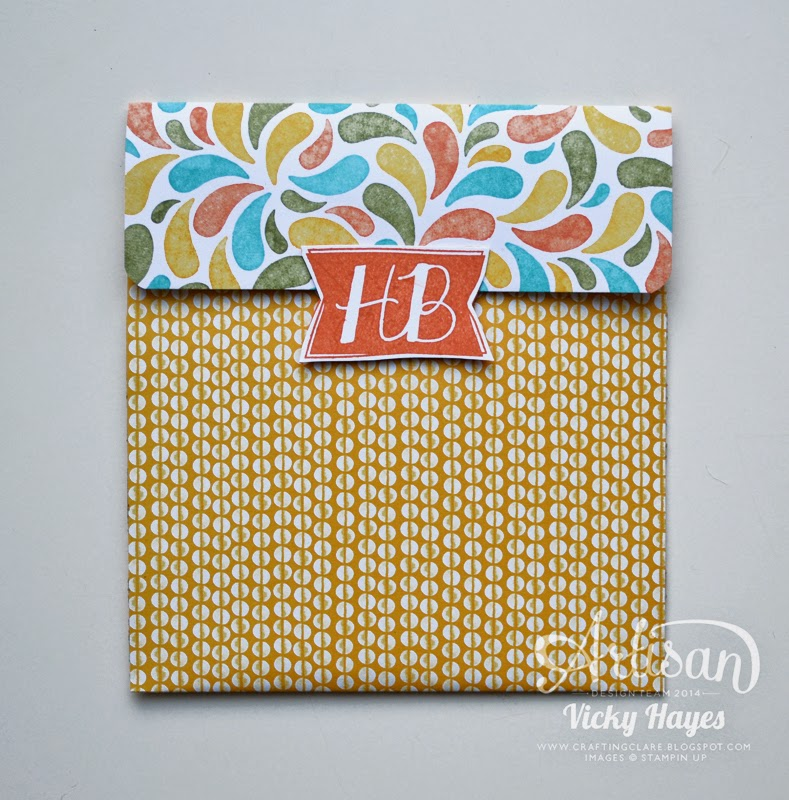 Use contrasting designer papers to make this simple gift pouch