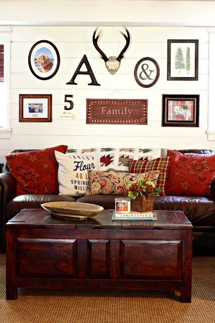Gallery wall with antlers in fall family room with plank wall-www.goldenboysandme.com