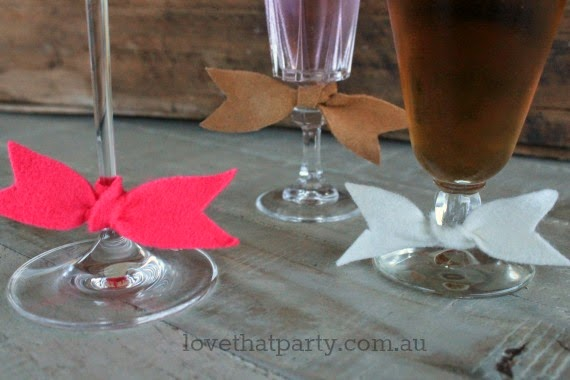 Simple and pretty wine glass bow ties to dress up your next cocktail party or gathering. via Love That Party