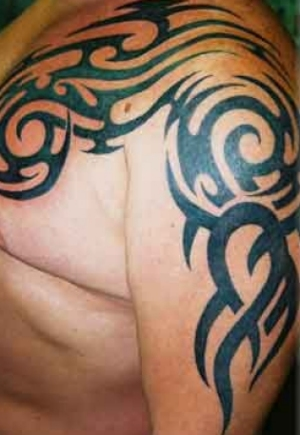 Tattoo in gallery tribal shoulder and arm tattoos for Shoulder and arm tattoos