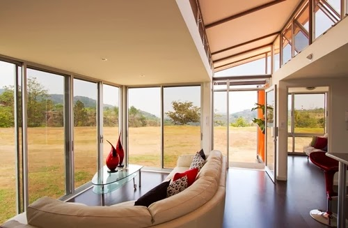 07-Looking-Out-Recycled-Container-House-Architect-Benjamin-Garcia-San-Jose-Costa-Rica-Solar-Panels-Recycled-Metal-www-designstack-co