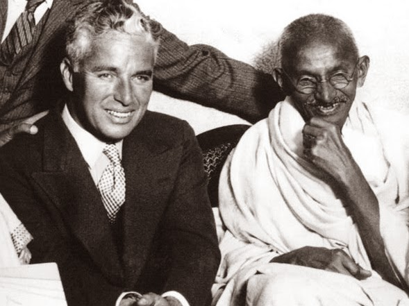 64 Historical Pictures you most likely haven't seen before. # 8 is a bit disturbing! - Charlie Chaplin and Mahatma Gandhi