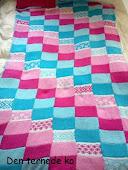 Plaid af strikkede firkanter