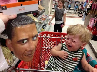 funny picture: crying child who is afraid of obama mask