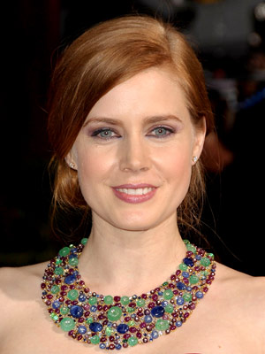 Smoothness in front and pin curls in back giveAmy Adams' formal hairstyle a refined touch.