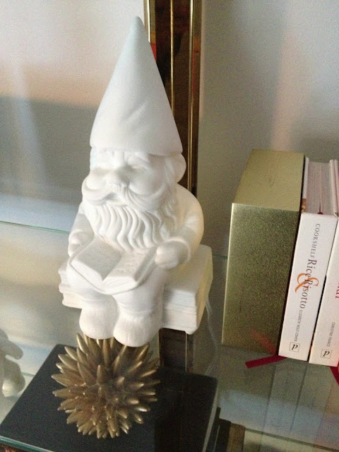 lighted gnomeo sitting on a shelf