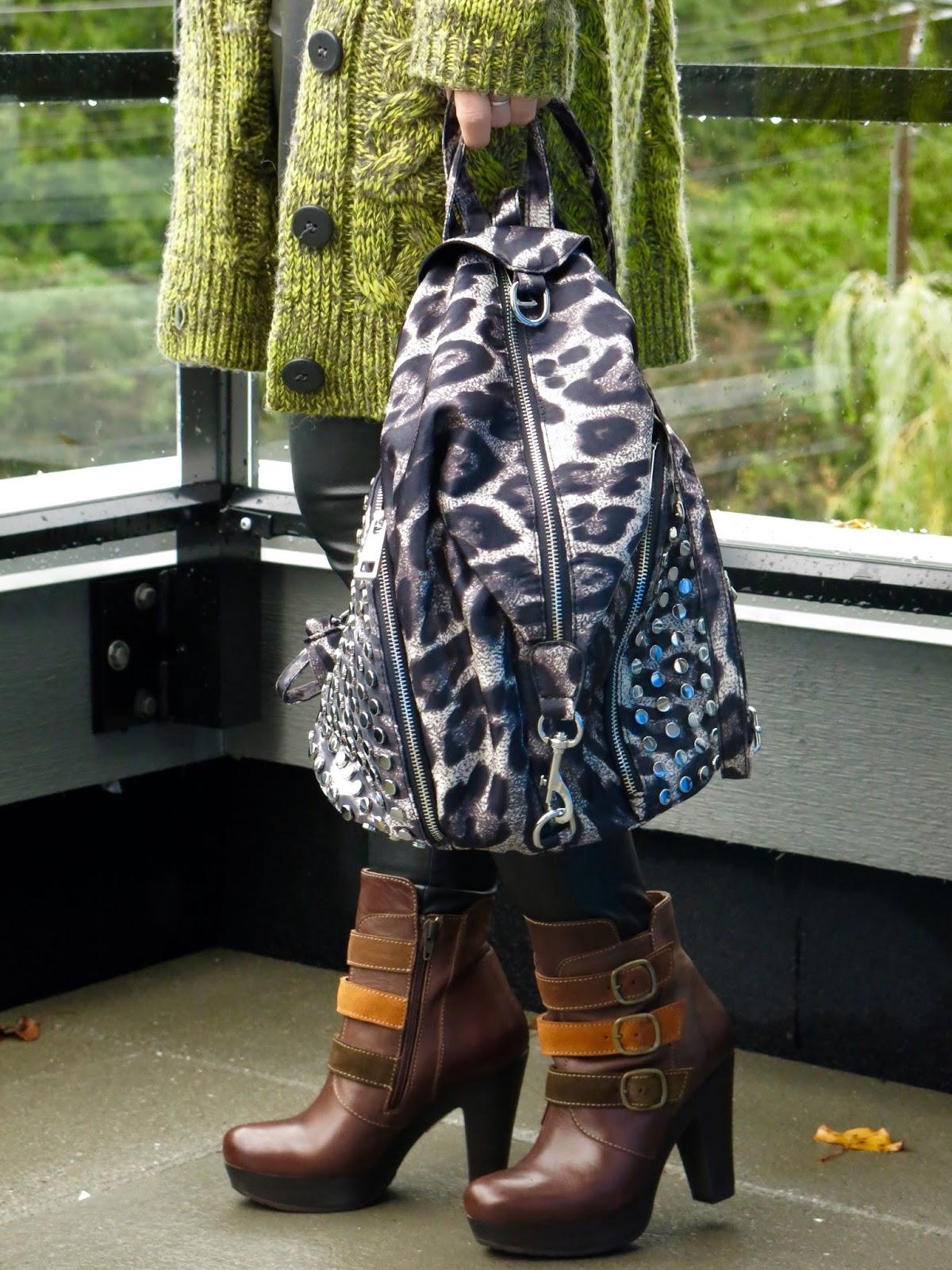 grandpa cardigan, faux-leather leggings, platform booties, and leopard-print backpack