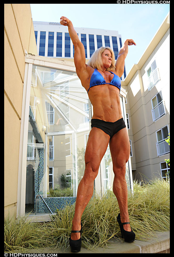 Lisa Giesbrecht Fkexing Her Shredded Muscles In A Blue Bikini Top