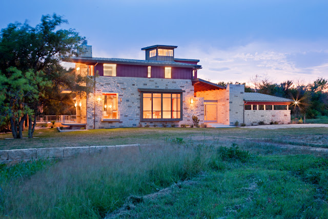 Picture of the contemporary house as seen at sunset from the back