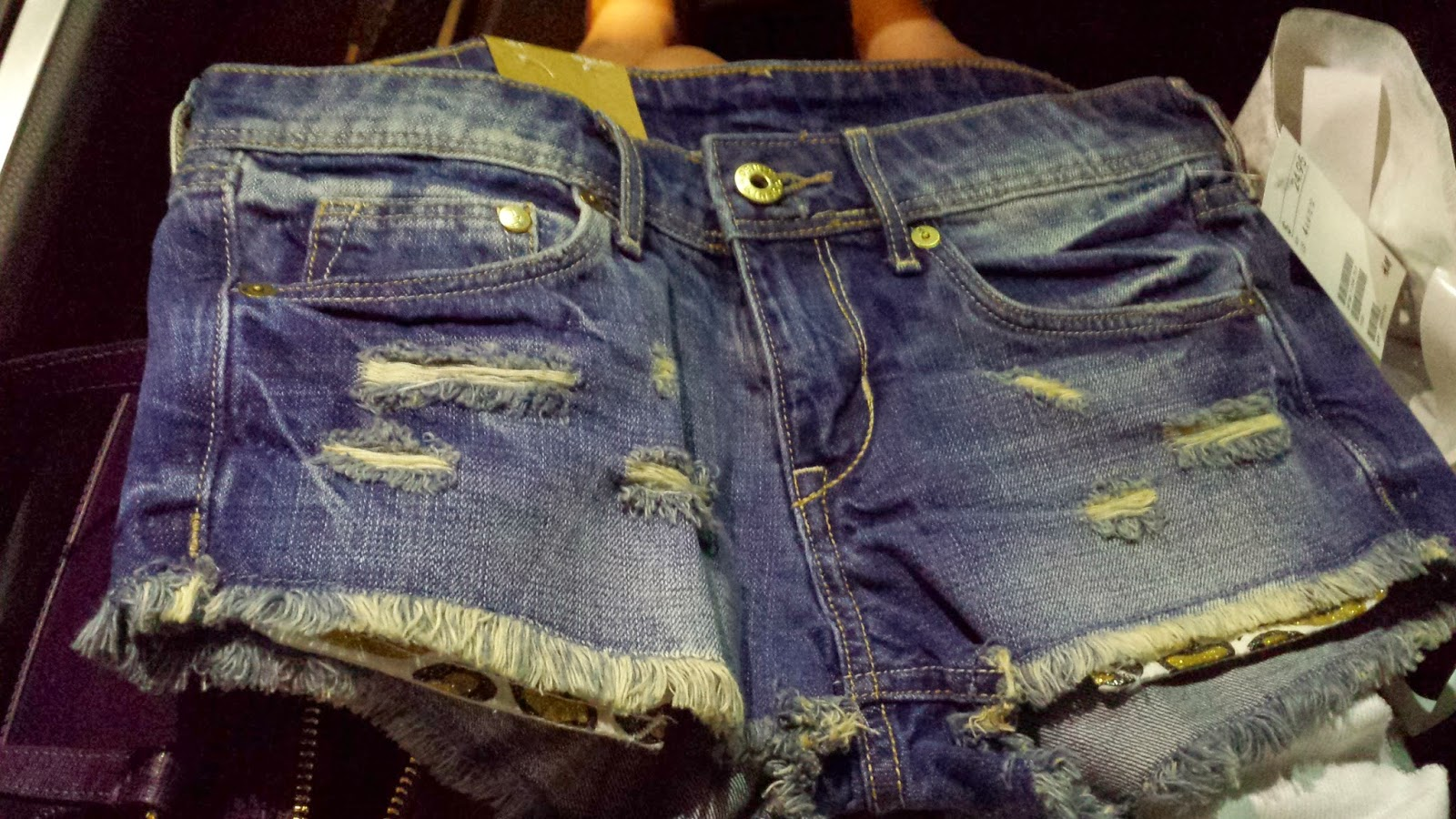 H&M distressed denim shorts sparkly leopard print pockets