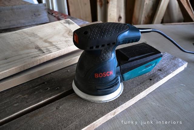 pallet wood gets sanded