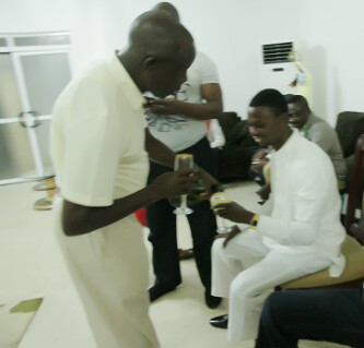 Comrade Adams Oshomole and Comedian I Go Die shares a bottle of wine on their birthday