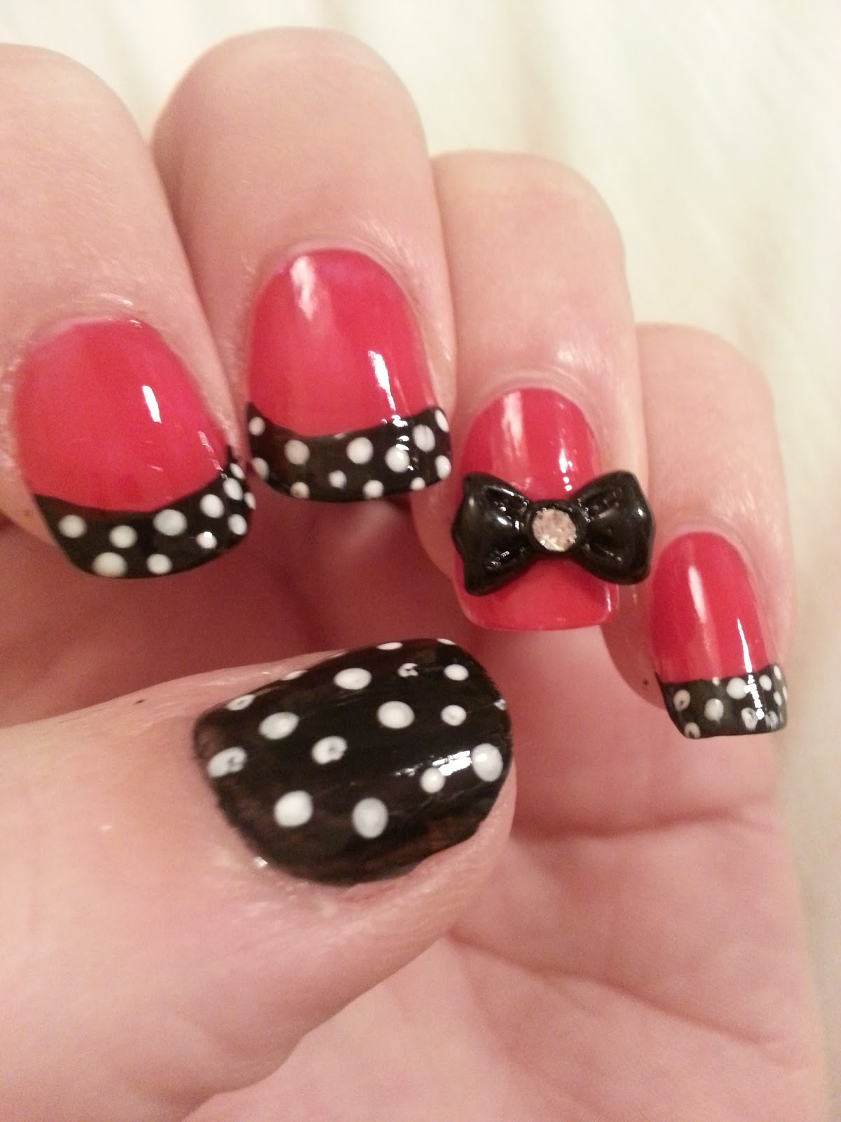 and then add your bow (add a dot of top coat to the nail and the bow
