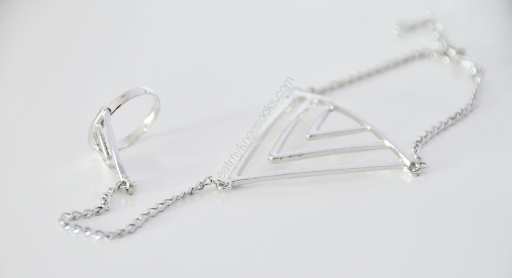 The modern, minimalist silver hand chain from Born Pretty Store.