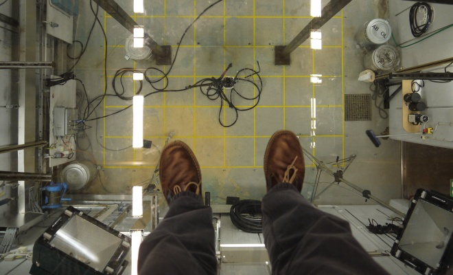 Crash test chamber glass floor