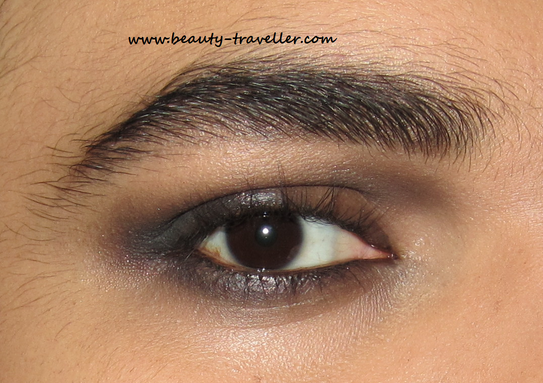 Apply Too Faced Eyeshadow In Nice Ash On The Upper And Lower Lids And Smoke  It