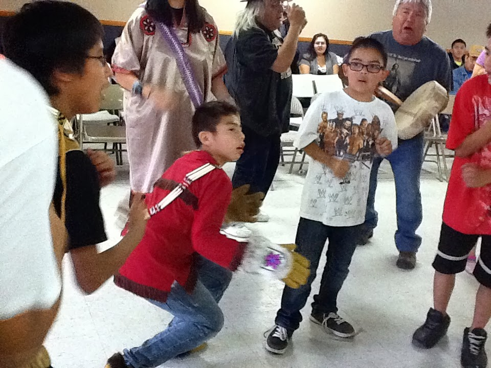 Young people dance at a Gulkana Village Potlatch for village Elder Fred Ewan