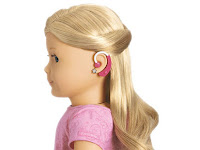Photo of American Girl doll wearing a hearing aid.