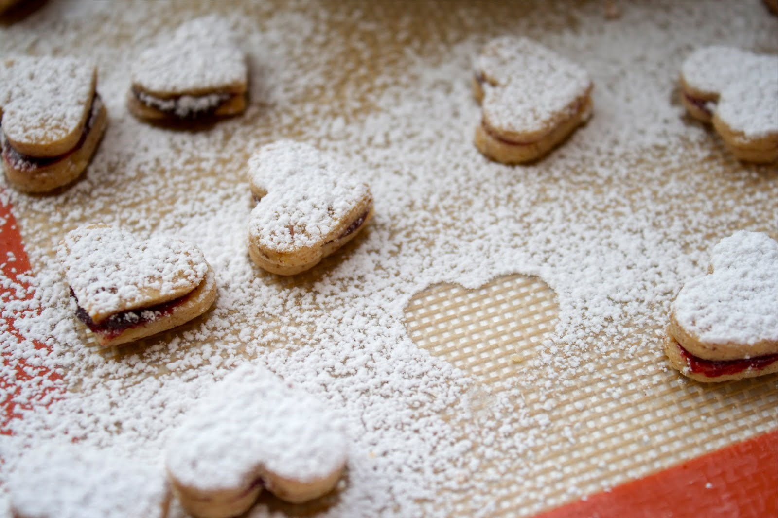 CosmoCookie: Pecan Linzer Heart Cookies with Black Cherry Filling