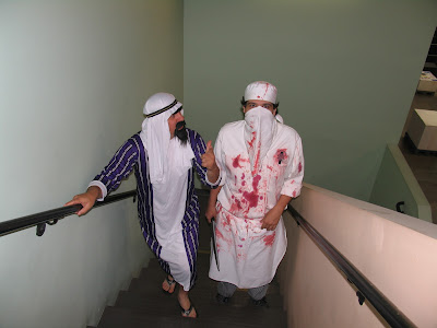 GotPrint halloween 2011 costumes arab and butcher walking up the stairs