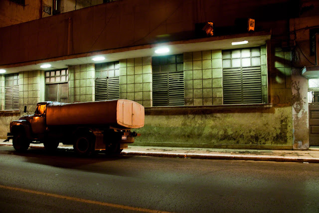 A fuel truck parked along Avenida 3 in Havana Cuba by Marlon Krieger