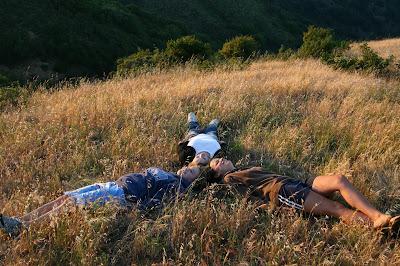 NAMC montessori adolescent programs erdkinder teens laying in field