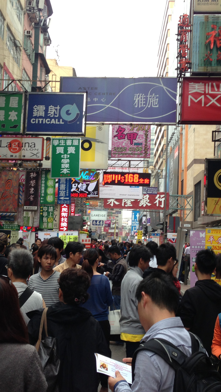 The busy streets of Mong Kok on a Sunday - and the busier signs. They get way busier at night, though.