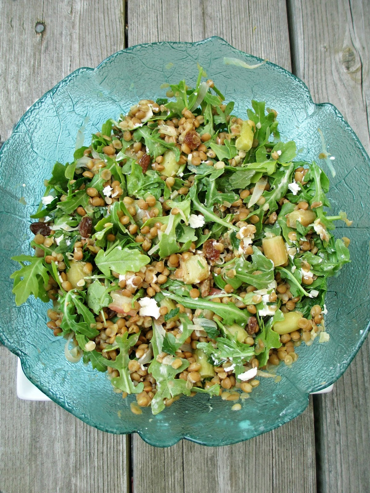seasonal salad combining rhubarb with lentils arugula and goat cheese