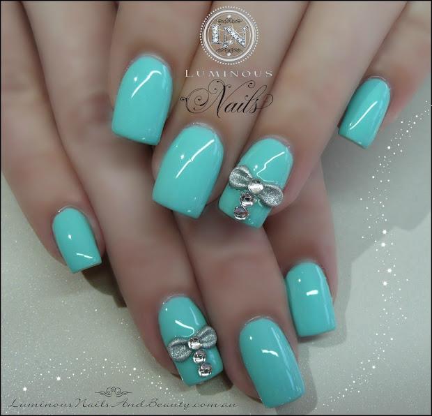 aqua blue nails with silver bows
