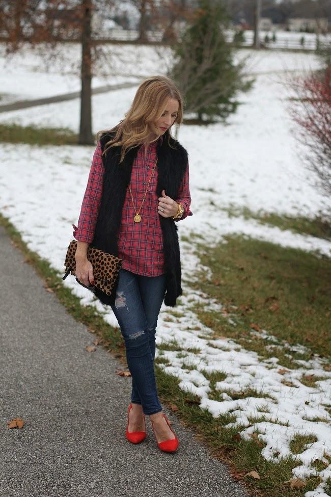 love token fur vest, jcrew plaid shirt, AG skinny jeans, Madewell red heels, Clare V leopard clutch