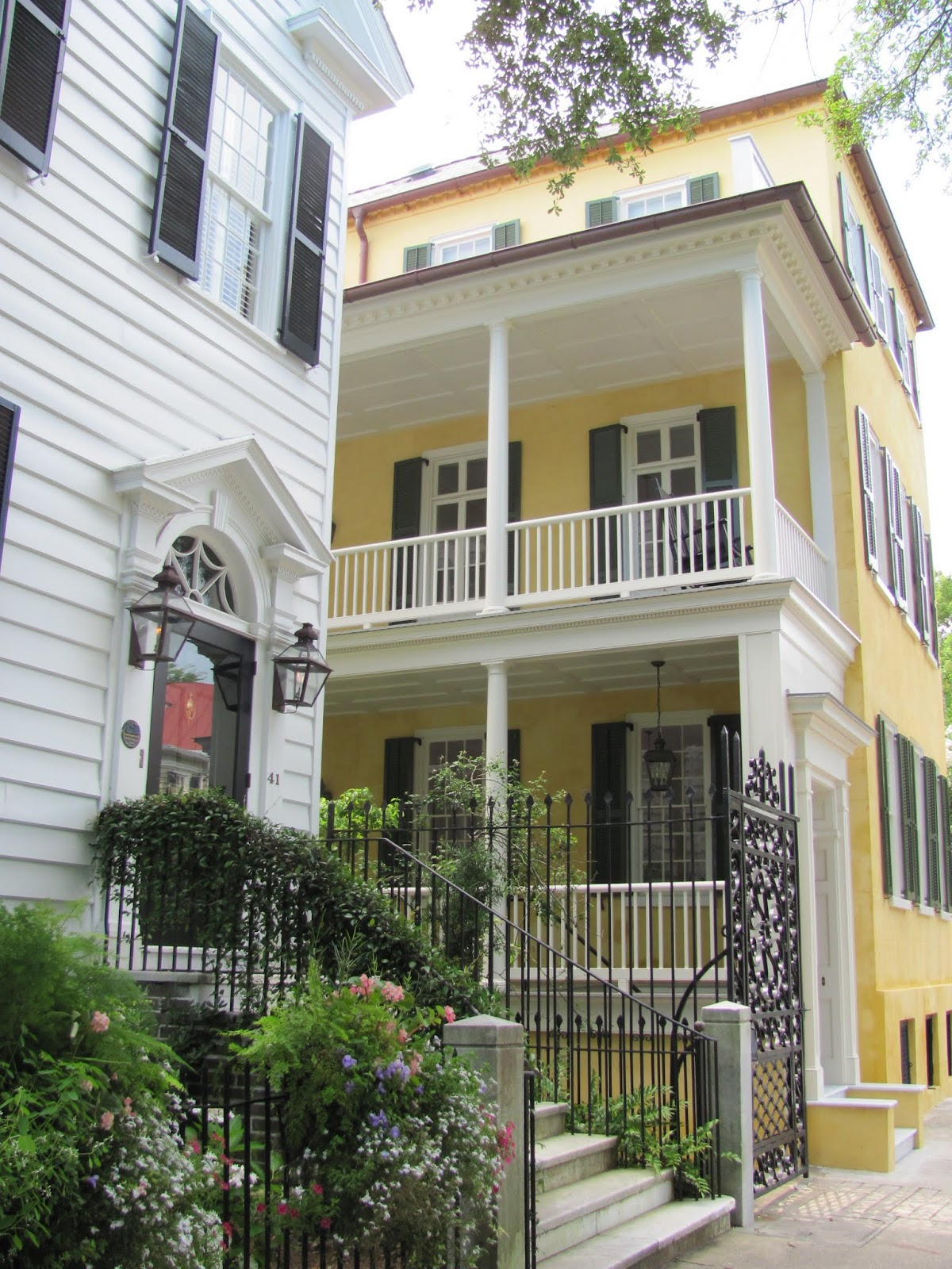 Yellow home with iron gates in Charleston, SC