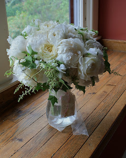 "Bowl of Cream peony, tender white sweet peas, white astilbe, David Austin ""Patience"" garden roses, and English ivy bridal bouquet - Otesaga Resort - Splendid Stems Floral Designs"