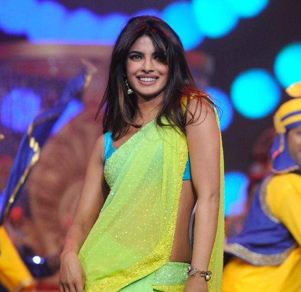 B-town diva Priyanka Chopra looks graceful in a sari at the Pond's Femina Miss India 2013 contest, held at Yash Raj Studios, in Mumbai, on March 24, 2013.