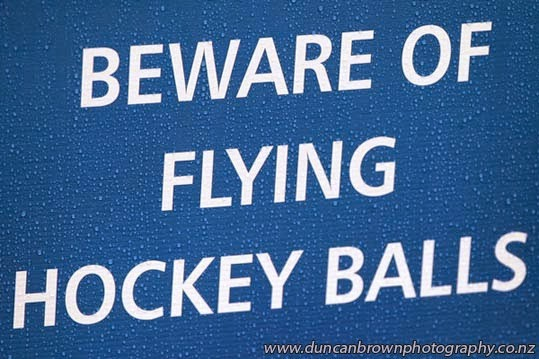 Beware of flying hockey balls - Enjoy the hockey photograph