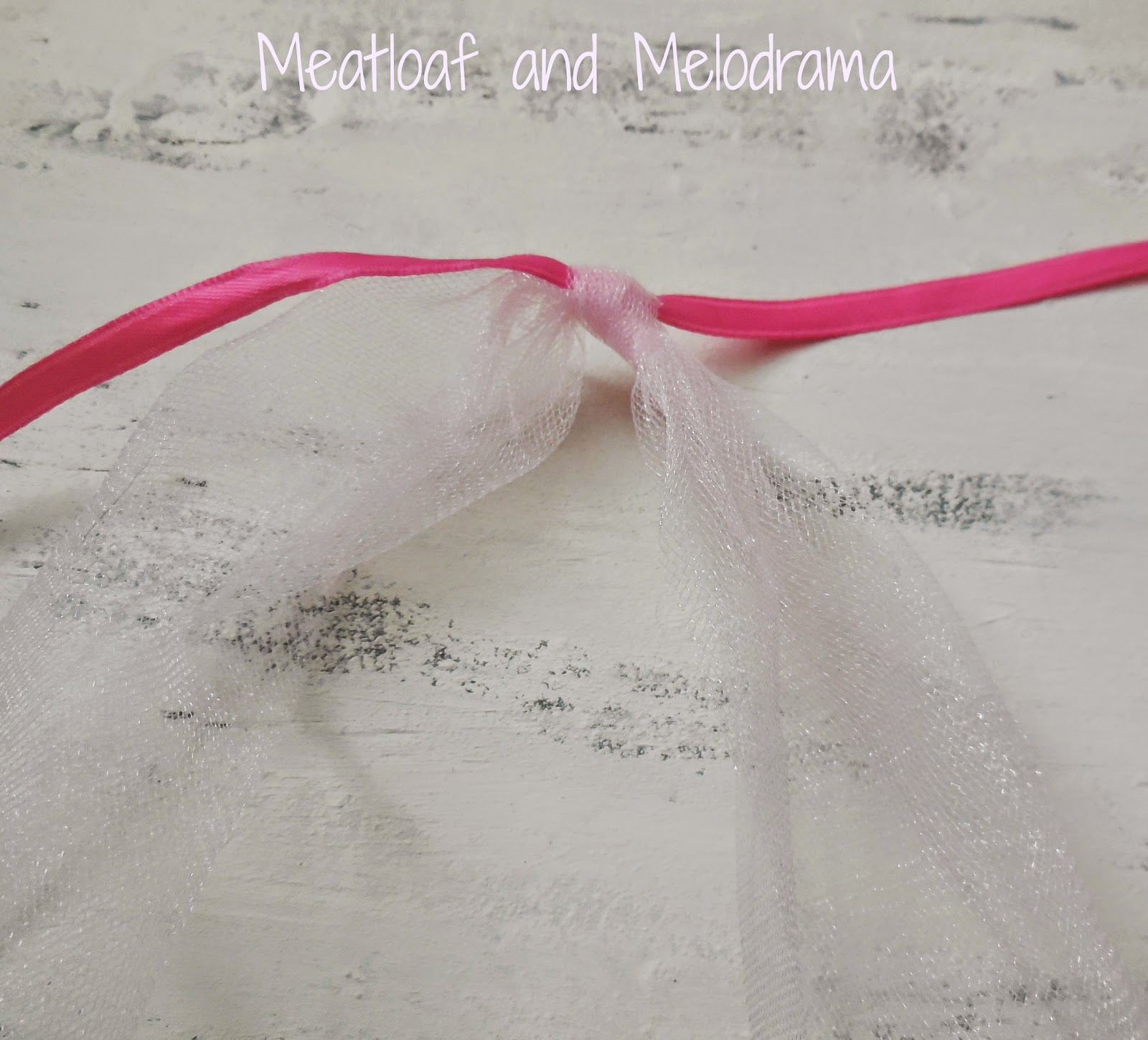 tie strips of tulle around a ribbon