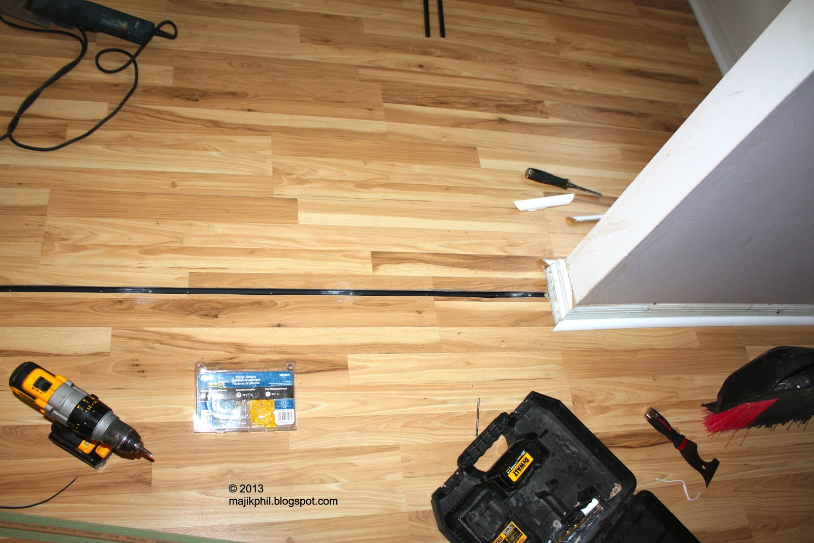 Laminate Floor Repair scratched oak flooring daniel friedman Above And Below Once The Expansion Slot Is Created A Track Is Installed Into The Subfloor The Subfloor Is Concrete So A Concrete Drill Is Used To Make