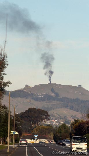 Car fire at the top of Te Mata Peak, Havelock North, pictured from St Aubyn St East, Hastings. The car was owned by Tali Notoa, Flaxmere, Hastings, who had taken his friends up the Peak for some sight-seeing. Havelock North Volunteer Fire Brigade attended. photograph