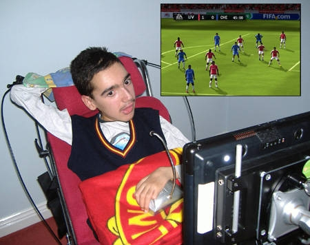 Photo of Alex Kostov playing Fifa 10 on his PC using eye-gaze and speech control.